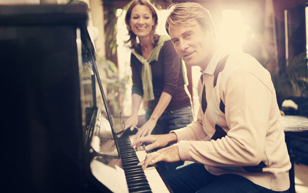 Man and woman playing piano