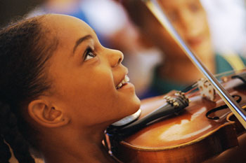 Happy Child Playing the Violin