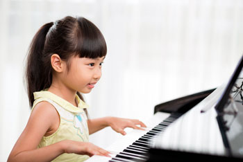 Young Girl Plays Piano